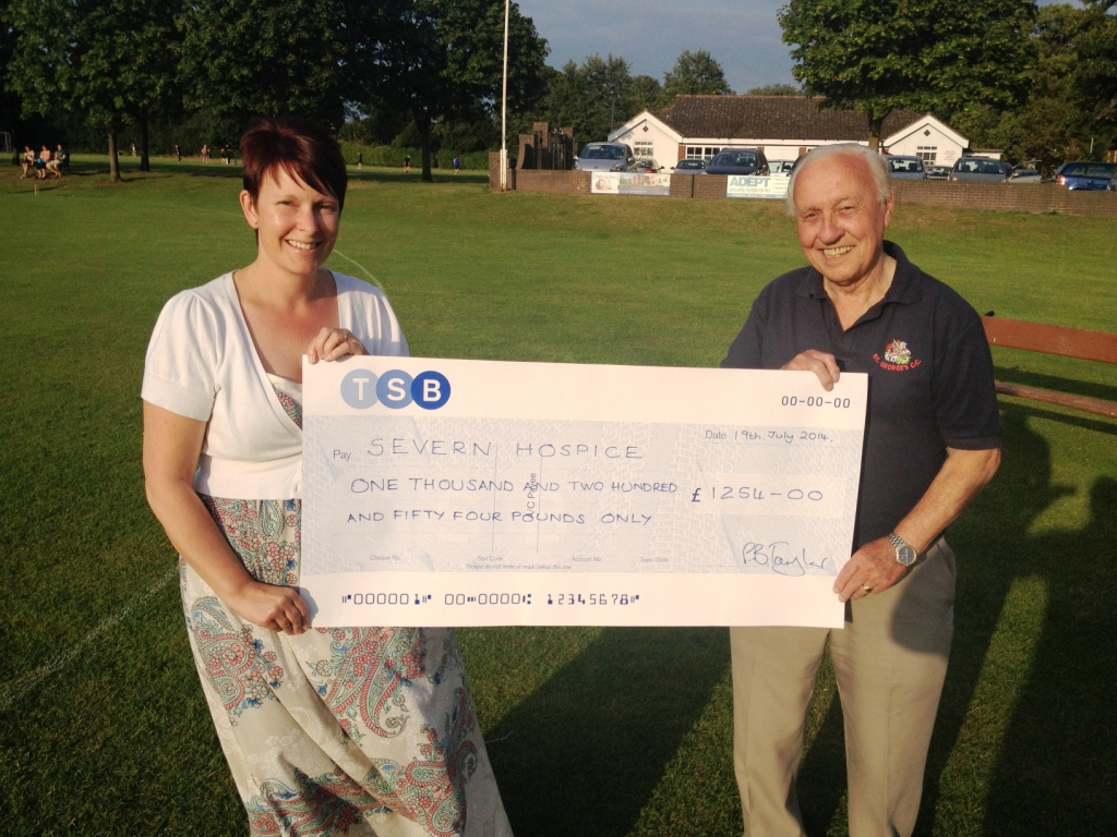 Sarah Hill receives the cheque on behalf of the Severn Hospice from club president Stan Higgins